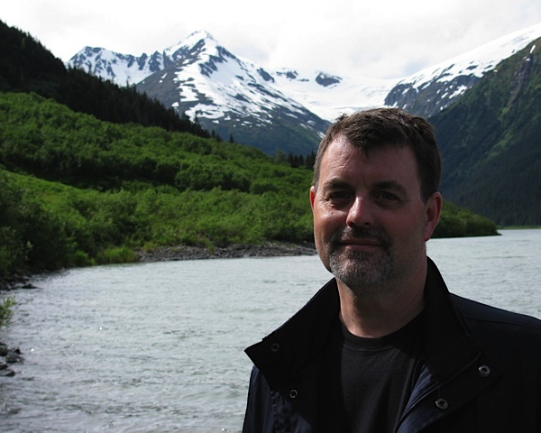 Rob by Alaskan lake